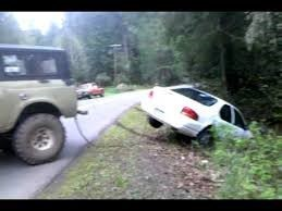 towing a white car out of a ditch